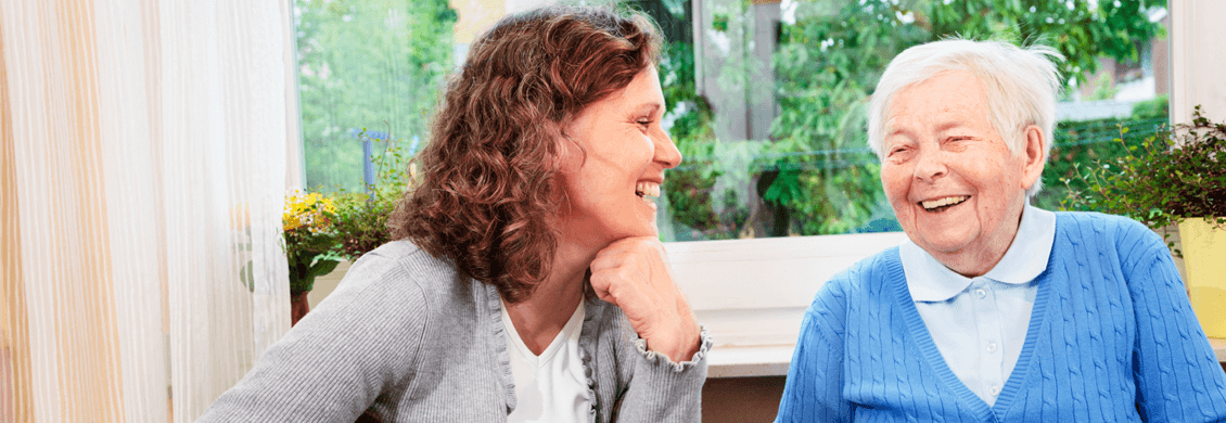 Older woman laughs with companion