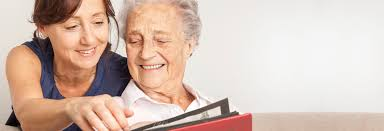 Companion looks at photographs with older woman